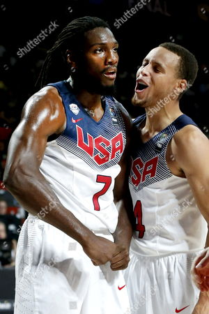 Usa's Power Forward Kenneth Faried (l) and Shooting Guard Stephen Curry (r) React During the Fiba Basketball World Cup Final Match Between the Usa and Serbia in Madrid Central Spain 14 September 2014 Spain Madrid