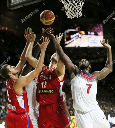 Stock Image of Kenneth Faried (r) of the Usa in Action Against Serbian Players Nenad Krstic (c) and Nemanja Bjelica (l) During the Fiba Basketball World Cup Final Match Between the Usa and Serbia in Madrid Central Spain 14 September 2014 Spain Madrid