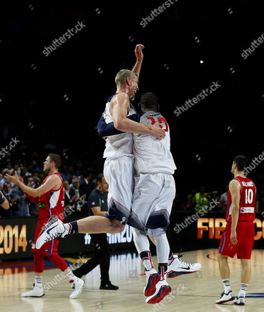 Mason Plumlee (c-left) and Kyrie Irving (c-right) of the Us Celebrate in Front of Serbian Player Nikola Kalinic (r) After Their Team's Victory in the Fiba Basketball World Cup Final Match Between the Usa and Serbia in Madrid Central Spain 14 September 2014 Spain Madrid