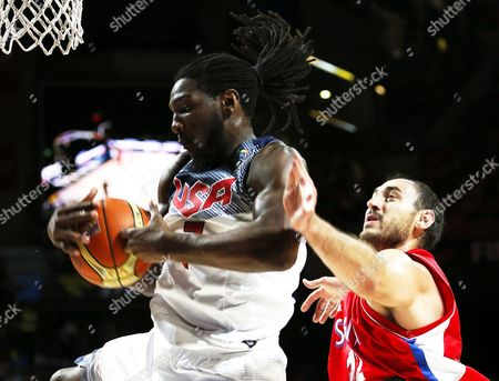 Kenneth Faried (l) of the Usa in Action Against Nenad Krstic (r) of Serbia During the Fiba Basketball World Cup Final Match Between the Usa and Serbia in Madrid Central Spain 14 September 2014 Spain Madrid