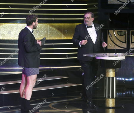 Spanish Cinema Academy President Enrique Gonzalez Macho (r) Chats with Gala's Presenter Dani Rovira (l) During the 29th Goya Awards Ceremony Held in Felipe Vi Congress in Madrid Spain 07 February 2015 the Goya Awards Are the Main National Annual Film Awards in Spain Spain Madrid