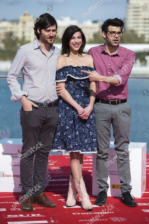 Spanish Filmmaker Carlos Marques-marcet (l) Poses For the Media Next to British Actress Natalia Tena and Spanish Actor David Verdaguer During the Presentation of the Film '10 000 Km' As Part of the Official Section During the 17th Annual Spanish Film Festival in Malaga Spain 24 March 2014 the Festival Runs From 21 to 29 March 2014 Spain Malaga