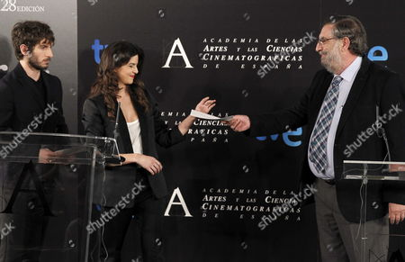 Spanish Film Academy's Chairman Enrique Gonzalez Macho (r) Gives the List of the Nominees For 28th Spanish Film Academy Awards to Actors Qim Gutierrez (l) and Clara Lago (c) During a Press Conference Held in Madrid Spain 07 January 2014 the 2014 Goya Awards Will Be Presented in a Ceremony Taking Place on Next 09 February Spain Madrid