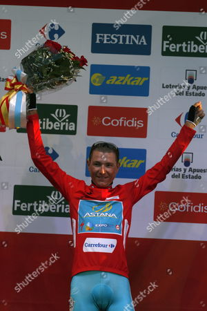 Slovak Cyclist Janez Brajkovic of Astana Team Celebrates on the Podium with the Red Jersey the Provisional Overall Leadership After the First Stage of the 2013 Vuelta a Espana Cycling Race a 27 4 Km Team Time Trial Between Vilanova De Arousa and Sanxenso Galicia Northwestern Spain 24 August 2013 Spain Sanxenxo