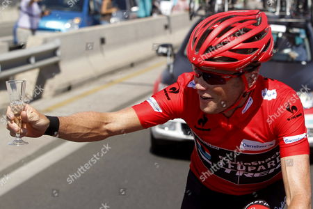 The Overall Leader Us Cyclist Chris Horner of Radioshack Team Celebrates with a Glass of Sparkling Wine During the 21st and Last Stage of the 2013 Vuelta a Espana Cycling Tour a 109 Km Race Between Leganes and Madrid Spain 15 September 2013 Spain Madrid