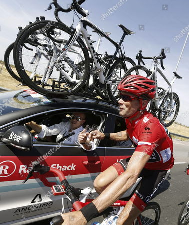 The Overall Leader Us Cyclist Chris Horner of Radioshack Team Drinks Sparkling Wine During the 21st and Last Stage of the 2013 Vuelta a Espana Cycling Tour a 109 Km Race Between Leganes and Madrid Spain 15 September 2013 Spain Madrid