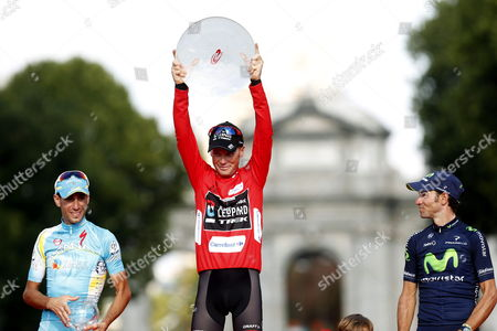 The Winner Us Cyclist Chris Horner (c) of Radioshack Team Celebrates on the Podium with Second Placed Italian Vincenzo Nibali (l) of Astana and Third Placed Spanish Rider Alejandro Valverde (r) of Movistar Team After the 21st and Last Stage of the 2013 Vuelta a Espana Cycling Tour a 109 Km Race Between Leganes and Madrid Spain 15 September 2013 Spain Madrid