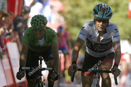 Us Cyclist Chris Horner (r) of Radioshack Team and Spaniard Alejandro Valverde (l) of Movistar Cross the Finish Line During the 19th Stage of the 2013 Vuelta a Espana Cycling Tour a 181 Km Race From San Vicente De La Barquera to Alto Naranco Spain 13 September 2013 Spain Alto Naranco