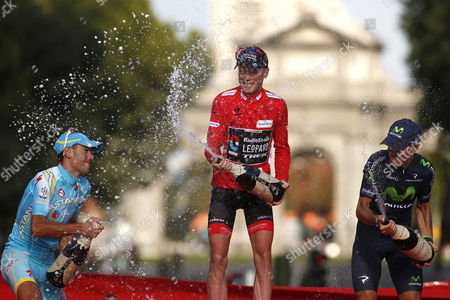 The Overall Leader Us Cyclist Chris Horner (c) of Radioshack Team Celebrates on the Podium Next to Second Placed Italian of Astana Vincenzo Nibali (l) and Spanish of Movistar Alejandro Valverde (r) Third Position After the 21st and Last Stage of the 2013 Vuelta a Espana Cycling Tour a 109 Km Race Between Leganes and Madrid Spain 15 September 2013 Spain Madrid