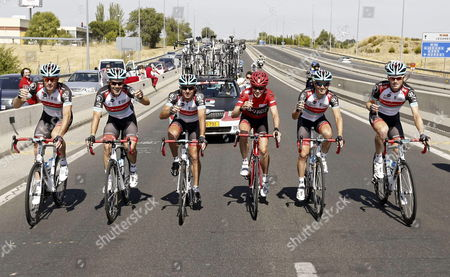 The Overall Leader Us Cyclist Chris Horner (3-r) of Radioshack Drinks Sparkling Wine with Team-mates During the 21st and Last Stage of the 2013 Vuelta a Espana Cycling Tour a 109 Km Race Between Leganes and Madrid Spain 15 September 2013 Spain Madrid