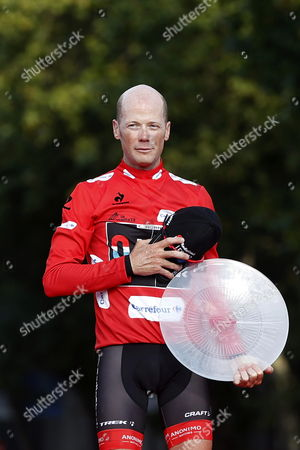 Overall Winner Us Cyclist Chris Horner of Radioshack Team Celebrates on the Podium After the 21st and Last Stage of the 2013 Vuelta a Espana Cycling Tour a 109 Km Race Between Leganes and Madrid Spain 15 September 2013 Horner Became the First American to Win the Vuelta and at Age 41 the Oldest Man to Win One of the Three Grand Tours in Cycling the Radioshack Rider Clinched Victory in the 68th Edition of the Spanish Race 37 Seconds Ahead of Italian Favourite and Astana Team Captain Vincenzo Nibali Spain Madrid
