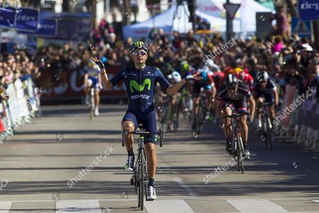 Spanish Cyclist Juan Jose Lobato (c) of the Movistar Team Celebrates While Crossing the Finish Line to Win the Final Stage of the 61st Vuelta Andalucia (tour of Andalusia) Cycling Race Between Montilla and Alhaurin De La Torre Southern Spain 22 February 2015 Spain Alhaurin De La Torre