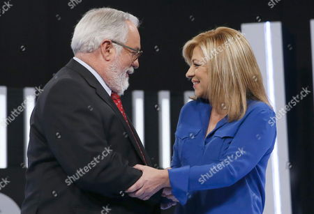 Popular Party Candidate For the European Parliament Miguel Arias Ca±ete (l) Greets Socialist Party Candidate Elena Valenciano (r) Before Starring the Televised Debate Celebrated in Madrid Spain 15 May 2014 Spain Madrid
