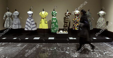 A Visitor Walks Pass Some of the Creations Displayed at the Exhibition 'The 50s: Fashion in France 1947-1957' at the Fine Arts Museum of Bilbao Basque Country Northern Spain 10 March 2015 the Show Which Features More Than 100 Models and Accessories by French Designers Such As Chanel Schiaparelli Balenciaga Balmain Christian Dior Jacques Griffe Hubert De Givenchy and Pierre Cardin Runs From 10 March Until 31 August 2015 Spain Bilbao