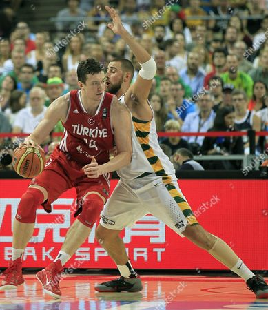 Omer Asik (l) of Turkey in Action Against Jonas Valanciunas of Lithuania During the Fiba Basketball World Cup Quarter Final Match Between Lithuania and Turkey at Palau Sant Jordi Sports Pavilion in Barcelona Catalonia North-eastern Spain 09 September 2014 Spain Barcelona