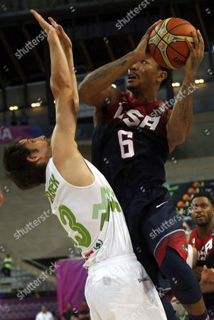 Usa Player Derrick Rose (r) Goes to the Basket in Opposition of Domen Lorbek (l) of Slovenia During the Fiba Basketball World Cup Quarter Final Match Between Slovenia and Usa Played at Sant Jordi Palace in Barcelona Northeasthern Spain 09 September 2014 Spain Barcelona
