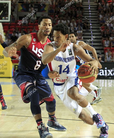 Us Player Derrick Rose (l) in Action Against Dominican Ronald Ramon (r) During the Fiba Basketball World Cup Match Group C Match Between Dominican Republic and the Usa at the Bizkaia Arena (bec) Pavilion in Bilbao Northern Spain 03 September 2014 Spain Bilbao