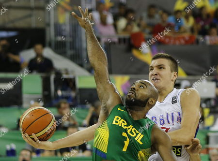 Serbia's Bogdan Bogdanovic (r) Fights For the Ball with Brazilian Larry Taylor During the Fiba Basketball World Cup Match Group a Match Between Serbia and Brazil at the Sports Palace of Granada Andalusia Spain 03 September 2014 Spain Granada