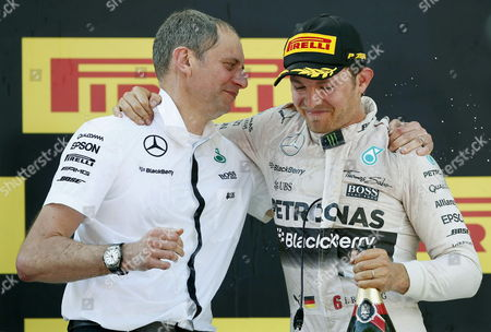 German Nico Rosberg (r) of Mercedes and His Team Chief Paddy Lowe Celebrate on Podium After Winning the Formula One Grand Prix of Spain at Montmelo Track Near Barcelona Northeastern Spain 10 May 2015 Spain Montmelo (barcelona)