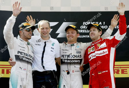 (l-r) British Lewis Hamilton (2nd Place) Mercedes' Chief Paddy Lowe and German Drivers Nico Rosberg (winner) and Sebastian Vettel (3rd) Celebrate on the Podium After the Formula One Grand Prix of Spain at Montmelo Track Near Barcelona Northeastern Spain 10 May 2015 Spain Montmelo (barcelona)