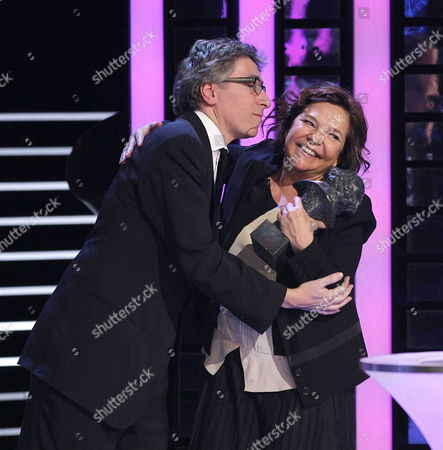 Spanish Director David Trueba (l) and Producer Cristina Huete (r) Pose For the Media After Receiving Their 'Best Film' Goya Award For His Film 'Vivir Es Facil Con Los Ojos Cerrados' During the 28th Goya Awards Awarding Ceremony in Madrid Spain 09 February 2014 Spain Madrid
