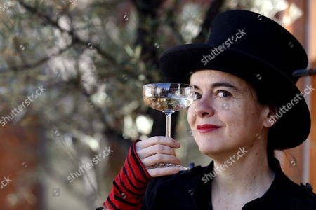 Belgian Writer Amelie Nothomb Cheers with a Glass As She Poses For Photographs During the Presentation of Her New Book 'Barbe Bleu' (lit: Bluebeard) in Barcelona Spain 06 February 2014 Nothomb Presents Charles Perrault's Classic Turned Into a New Version That Inspires Both Horror and Humor Spain Barcelona