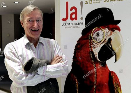 British Writter Julian Barnes Poses For Photographers Next to the Official Poster of the La Risa International Humor Festival in Bilbao Spain 10 October 2014 Barnes Special Guest of This Year's Edition Will Be Awarded with the Bbk La Risa Prize the Event Runs From 02 to 12 October Spain Bilbao