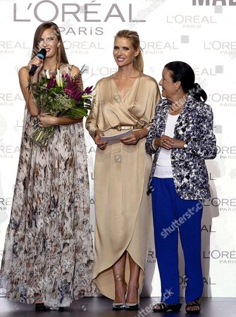 Spanish Model Judith Masco (c) and Director of the Madrid Fashion Week Cuca Solana (r) Give the Best Model Award of the 58th Edition of the Madrid Fashion Week to Alla Kostromichova (l) in Madrid Spain 16 September 2013 the Madrid Fashion Week Runs Until 17 September 2013 Spain Madrid