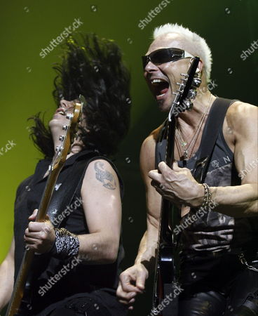 Guitarist of the German Heavy Metal Band Scorpions Rudolf Schenker (r) and Polish Bassist Pawel Maciwoda Perform on Stage During the Concert Held at Palacio Vistalegre in Madrid Spain 07 March 2014 Spain Madrid