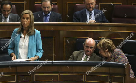 Spanish Health Minister Ana Mato (l) Delivers a Speech Next to Economy Minister Luis De Guindos (c) and Lower Chamber's Deputy Speaker Celia Villalobos (r) During a Plenary Session at the Lower House of the Spanish Parliament in Madrid Spain 08 October 2014 Mato Said 'Spain is Perfectly Prepared to Face Ebola' and Assured That There is No Signs of the People who Came Into Contact with an Ebola Infected Nurse Having Any Symptoms Mato Added These People Are Under Exhaustive Medical Control and There is Another Nurse Undergoing Tests Spain Madrid