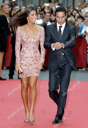 Isabel Preysler's Children Ana Boyer (l) and Spanish Singer Julio Iglesias Jr (r) Arrive to the Wedding of Maria Colonques One of the Daughters of Porcelanosa's Owner with Chemist Andres Benet at Villarreal's Archpriestal Parish in Villarreal Castellon Province Eastern Spain 11 October 2013 Spain Villarreal (castellón)