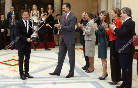 Spanishking Felipe Vi (c) in Presence of (5r-r) Spanish Culture and Sports Minister Jose Ignacio Wert Queen Sofia Queen Letizia Princess Elena and the Chairman of Spanish Sports Council Miguel Cardenal Presents the Iberoamerican Community Trophy to Atletico Madrid's Argentinian Head Coach Diego Pablo Simeone (l) During the National Sports Awards Ceremony at El Pardo Palace in Madrid Spain 04 December 2014 Spain Madrid
