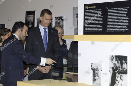 Spanish Crown Prince Felipe (c) Listens to Curator Antonio Lopez Vega (l) on the Opening Day of the Exhibition 'Generation of 14 Science and Modernity' at the National Library in Madrid Spain 13 March 2014 the Exibition Which Runs From 14 March and 1 June 2014 Explores the Life and Works of Writers Such As Jose Ortega Y Gasset Gabriel Miro Ramon Perez De Ayala Juan Ramon Jimenez and Ramon Gomez De La Serna Spain Madrid