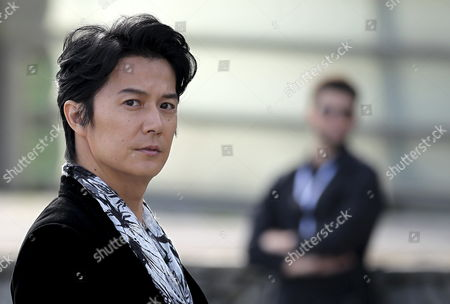 Japanese Actor/cast Member Masaharu Fukuyama Poses During a Photocall For 'Soshite Chichi Ni Naru (like Father Like Son)' During the 61st San Sebastian International Film Festival at La Concha Beach in San Sebastian Spain 21 September 2013 the Movie is Presented in the Pearls Section of the Festival Running From 20 to 28 September Spain San Sebastian