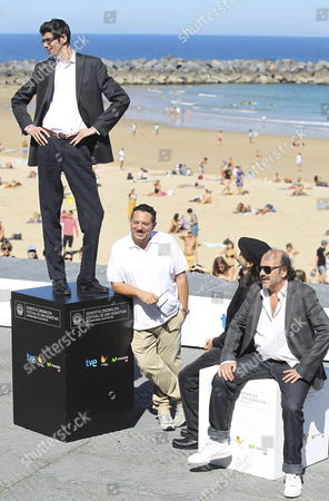 Stock Image of Spanish Actors/cas Members Manuel Tallafe (r) Santiago Segura (2-r) Pepon Nieto (2-l) and Javier Botet (l) Pose at La Concha Beach During the 61st San Sebastian International Film Festival in San Sebastian Spain 22 September 2013 the Movie is Presented out of Competition at the Festival Running From 20 to 28 September Spain San Sebastian