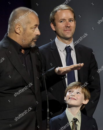 French Director Jean-pierre Jeunet (l) Us Author Reif Larsen (r) and Actor Kyle Catlett (below) Introduce the Film 'The Young and Prodigious Spivet' Base on the Book by Larsen 'The Selected Works of T S Spivet' During the Closing Ceremony of the 61st San Sebastian Film Festival in San Sebastian Northern Spain 28 September 2013 Spain San Sebastian
