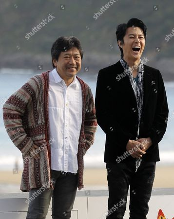 Japanese Director Hirokazu Kore-eda (l) and Actor Masaharu Fukuyama (r) Pose During a Photocall For 'Soshite Chichi Ni Naru (like Father Like Son)' During the 61st San Sebastian International Film Festival at La Concha Beach in San Sebastian Spain 21 September 2013 the Movie is Presented in the Pearls Section of the Festival Running From 20 to 28 September Spain San Sebastian
