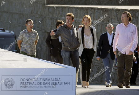 (front L-r) Spanish Actor Antonio De La Torre Italian Actress Olimpia Melinte and Spanish Director Manuel Martin Cuenca Arrive at the Photocall For 'Canibal' (cannibal) During the 61st San Sebastian International Film Festival in San Sebastian Spain 23 September 2013 the Movie is Presented in the Official Selection of the Festival Running From 20 to 28 September Spain San Sebastian