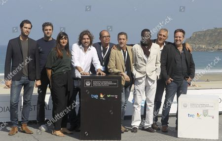 French Filmmaker Laurent Cantet (2-l) Poses with Actors Jorge Perugorria (r) Nestor Luis Jimenez (c) Pedro Julio Diaz Ferran (3-r) and Fernando Rogelio Hechavarria (4-r) at the Photocall For 'Return to Ithaca' During the 62nd San Sebastian International Film Festival in San Sebastian Spain 26 September 2014 the Festival Runs Until 27 September Spain San Sebastian