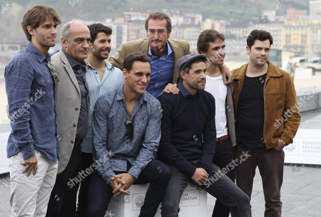 Stock Image of Spanish Filmmaker Pablo Malo (c-back) Poses with Actors Ricard Sales (l-seated) Unax Ugalde (r-seated) Inigo Gastesi (l) Francesc Orella (2-l) Cristian Merchan (3-l) Jon Anza (2-r) Oriol Vila (r) Producer Joxe Portela (3-r) and Scriptwriter Joanes Urkixo (2-r) to Present 'Lasa and Zabala' During the 62nd San Sebastian International Film Festival in San Sebastian Basque Country Spain 25 September 2014 Spain San Sebastian