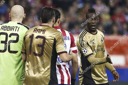 Ac Milan's Players Mario Balotelli (r) Adil Rami (2l) and Christian Abbiati (l) During the Uefa Champions League Round of 16 Second Leg Soccer Match Played at Vicente Calderon Stadium in Madrid Spain on 11 March 2014 Spain Madrid