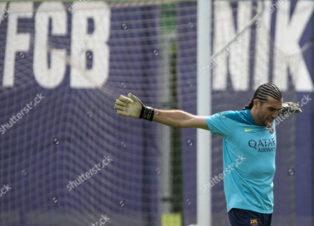 Goalkeeper of Fc Barcelona Jose Manuel Pinto Stretches During a Training Session at the Joan Gamper Sports Complex in Barcelona North-estern Spain 10 May 2014 the Fc Barcelona Will Face Elche in a Spain's Primera Division League Soccer Match on 11 May 2014 Spain Barcelona