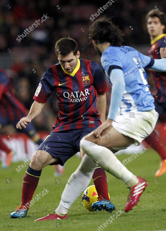 Fc Barcelona's Leo Messi (l) in Action Against Malaga's Sergio Sanchez During the Spanish Liga Primera Division Match Between Fc Barcelona and Malaga at Camp Nou Stadium in Barcelona Spain 26 January 2014 Spain Barcelona