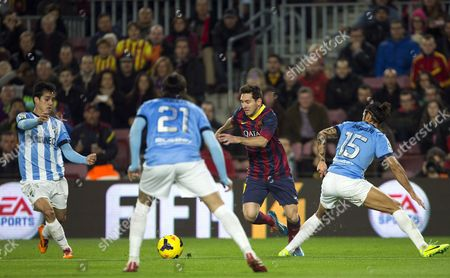 Fc Barcelona's Lionel Messi (2-r) in Action Against (l-r) Malaga's Juanmi Jimenez Sergio Sanchez and Defender Marcos Angeleri During the Spanish Liga Primera Division Match Between Fc Barcelona and Malaga at Camp Nou Stadium in Barcelona Spain 26 January 2014 Spain Barcelona