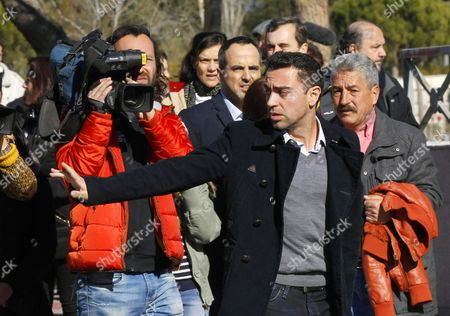 Fc Barcelona's Midfielder Xavi Hernandez Arrives to the Funeral Chapel to Pay His Respect For Former Spanish National Coach Luis Aragones in Madrid Spain 02 February 2014 Luis Aragones Coach of Spain's Uefa Euro 2008 Winning Team Died on 01 February 2014 in the Clinica Cemtro Hospital in Madrid at the Age of 75 After a Long Illness Spain Madrid