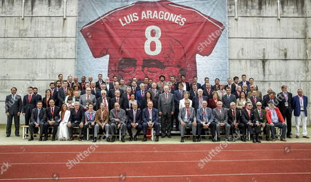 Spanish National Soccer Team Coach Vicente Del Bosque (c) Pose Next to Members of the Team That Won the Eurocup in 1964 During a Ceremony where a T-shirt of the Spanish National Team with the Name and the Image of Late Coach and Former Soccer Player Luis Aragones Has Been Put on a Wall As a Homage at Las Rozas Soccer City in Madrid Spain 19 May 2014 Spain Madrid