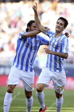 Malaga Fc's Midfielder Luis Alberto (r) Jubilates with His Team Mate Defender Sergio Sanchez (l) His Goal Against Athletic Bilbao During Their Primera Division Soccer Match Played at La Rosaleda Stadium in Malaga Andalusia Spain on 23 August 2014 Spain Malaga