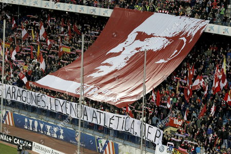 Supporters of Atletico Madrid Display a Huge Banner Depicting Late Spanish Soccer Coach Luis Aragones Before the Spanish Primera Division Soccer Match Between Atletico Madrid and Real Sociedad Played at Vicente Calderon Stadium in Madrid Spain 02 February 2014 Luis Aragones Coach of Spain's Uefa Euro 2008 Winning Team Died on 01 February 2014 in the Clinica Cemtro Hospital in Madrid at the Age of 75 After a Long Illness Spain Madrid