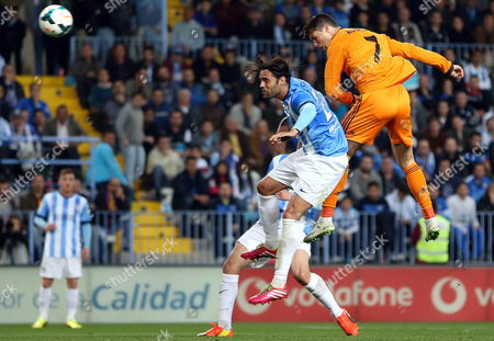 Real Madrid's Portuguese Striker Cristiano Ronaldo (r) Tries to Score Next to Defender Sergio Sanchez (l) of Malaga During Their Primera Division Soccer Match Played at La Rosaleda Stadium in Malaga Andalusia Spain 15 March 2015 Spain Malaga