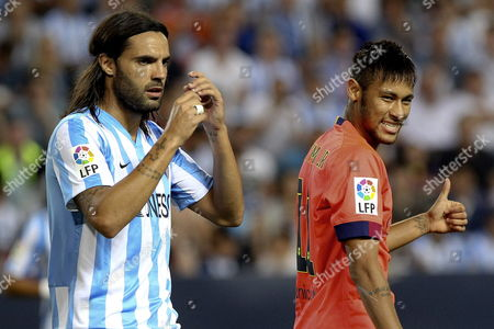 Fc Barcelona?s Neymar Da Silva (r) Gestures in Presence of Sergio Sanchez (l) of Malaga Cf During Their Spanish Primera Division Soccer Match Played at La Rosaleda Stadium in Malaga Andalusia Spain on 24 September 2014 Spain Mßlaga